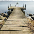 Old wooden pier on the lake — Stock Photo