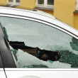 Broken passenger window, car theft - Stock Photo