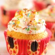 Stock Photo: Cupcakes with whipped cream