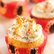 Cupcakes with whipped cream - Stock Photo