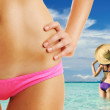 Women with beautiful body at beach — Stock Photo
