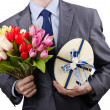 Businessmwith giftbox and flowers — Stock Photo #10069788
