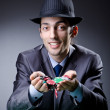 Casino player playing with chips — Stockfoto
