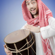 Arab playing drum in studio shooting — Stok fotoğraf