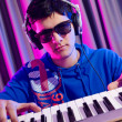 Young DJ playing his music — Stock Photo
