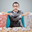 Man with lots of wasted paper — Stock Photo #10071558