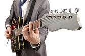 Young guitar player isolated on white — Stock Photo