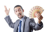 Young businessman with euro on white — Stock Photo
