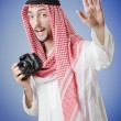 Arab photographer in studio shooting — Stock fotografie