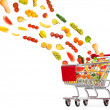 Food products flying out of shopping cart — Stock Photo #10225320