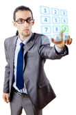 Businessman pressing virtual buttons — Stock Photo