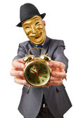 Masked man with clock on white — Stock Photo