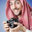 Stock Photo: Arab photographer in studio shooting