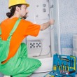 Plumber working in the bathroom - ストック写真