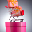 Christmas shopping concept with shopping cart — Stock Photo