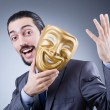 Stock Photo: Businessmwith mask concealing his identity