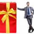 Businessman with gift boxes on white - Stock Photo
