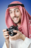 Arab photographer in studio shooting — Stock Photo