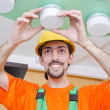 Electrician working on cabling lighting — Stock Photo
