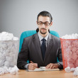 Man with lots of wasted paper — Stock Photo #10452747
