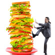 Man and giant sandwich on white - Lizenzfreies Foto
