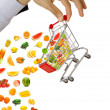 Food products flying out of shopping cart — Stock Photo #10453877