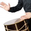 Drummer with drum playing on white — Foto Stock
