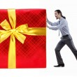 Businessman with gift boxes on white — Stock Photo