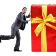 Businessman with gift boxes on white — Stock Photo #10573386
