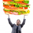 Man and giant sandwich on white — Stock Photo #10573397