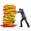 Man and giant sandwich on white — Stock Photo #10573403
