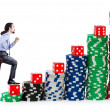 Businessman climbing stacks of casino chips — Stock Photo #10573439