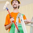 Painter worker during painting job - Stock Photo