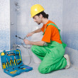 Plumber working in bathroom — Stock Photo #10573621