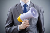 Man shouting and yelling with loudspeaker — Stock Photo