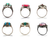 Set of jewellery rings on white — Stock Photo
