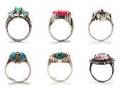 Set van juwelen ringen op wit — Stockfoto