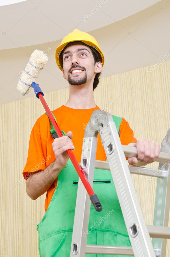 Painter worker during painting job — Stock Photo #10573540