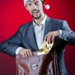 Businessman celebrating christmas holidays — Stock Photo #7968640