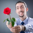 Young man with red rose — Stock Photo #7968719