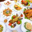 Stock Photo: Table served with tasty meals