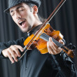 Fiddler playing the violin - Stock Photo
