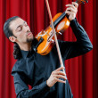 Violin player playing the intstrument - Foto Stock