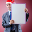 Businessman with santa hat and message — Stock Photo