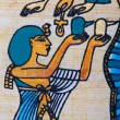 Fragment of egyptian papyrus - Stock Photo