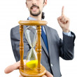 Man holding hourglass on white — Stock Photo
