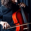 Cello player during performance - Stock Photo