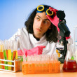 Stock Photo: Chemist in lab experimenting with solutions