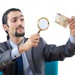 Man examining couterfeir money — Stock Photo