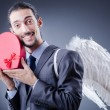 Man with wings and giftbox — Photo